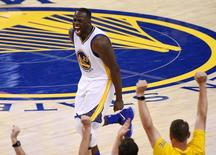 Jun 5, 2016; Oakland, CA, USA; Golden State Warriors forward Draymond Green (23) reacts to a play during the second quarter against the Cleveland Cavaliers in game two of the NBA Finals at Oracle Arena. Mandatory Credit: Kyle Terada-USA TODAY Sports