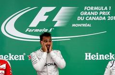 Mercedes F1 driver Lewis Hamilton of Britain reacts after winning the race. REUTERS/Chris Wattie