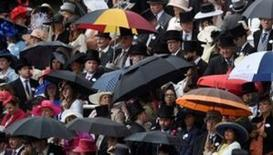 Britain Horse Racing - Royal Ascot - Ascot Racecourse - 14/6/16 General view as racegoers shelter from the rain Reuters / Toby Melville Livepic
