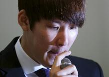 South Korea's former Olympic swimming champion Park Tae-hwan reacts as he answers reporters' questions during a news conference at a hotel in Seoul March 27, 2015.  REUTERS/Kim Hong-Ji