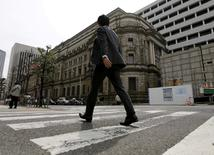 A businessman walks past the Bank of Japan (BOJ) building in Tokyo, Japan, March 23, 2016.   REUTERS/Toru Hanai/File Photo