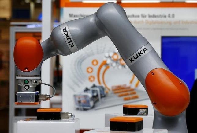 The logo of German industrial robot maker Kuka is pictured on a Kuka robot arm during the Hannover Fair in Hanover, Germany, April 25, 2016.    REUTERS/Wolfgang Rattay