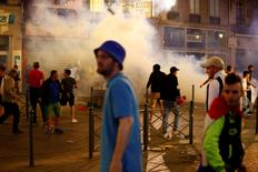 England fans run through tear gas in Lille.      REUTERS/Wolfgang Rattay