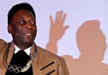 Brazilian soccer legend Pele poses for picture after receiving an Olympic necklace from President of the International Olympic Committee (IOC) Thomas Bach at the Pele Museum in Santos, Brazil June 16, 2016. REUTERS/Paulo Whitaker