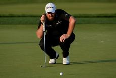 Jun 18, 2016; Oakmont, PA, USA; Shane Lowry lines up a putt on the 11th green during the third round of the U.S. Open golf tournament at Oakmont Country Club. Mandatory Credit: Michael Madrid-USA TODAY Sports