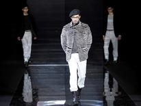 A model presents a creation as part of the Giorgio Armani Fall/Winter 2010/11 Men's collection during Milan Fashion Week in Italy January 19, 2010. REUTERS/Alessandro Garofalo/File Photo