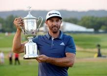 Jun 19, 2016; Oakmont, PA, USA; Dustin Johnson holds up the championship trophy after winning the U.S. Open golf tournament at Oakmont Country Club. Mandatory Credit: Michael Madrid-USA TODAY Sports