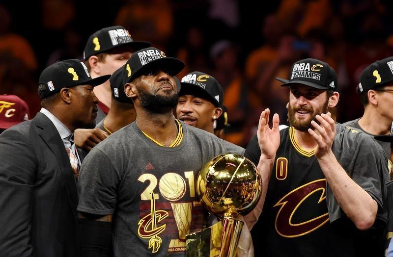 Jun 19 2016 Oakland CA USA Cleveland Cavaliers Forward LeBron James 23 Celebrates With The Larry OBrien Championship Trophy After Beating Golden