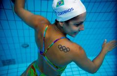 Brazil's synchronised swimmer Lara Teixeira poses for a photograph after a training session at the Maria Lenk Aquatic Centre in Rio de Janeiro, Brazil, May 20, 2016. REUTERS/Pilar Olivares