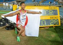 Jul 15, 2015, Cali, Columbia; Abdul Hakim Sani Brown (JPN) poses after winning the 100m in a championship record 10.28 during the 2015 IAAF World Youth Championships at Estadio Olimpico Pascual Guerrero. Mandatory Credit: Kirby Lee-USA TODAY Sports