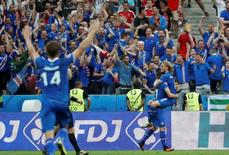 Iceland's Arnor Ingvi Traustason celebrates with Birkir Bjarnason after scoring the second goal.            REUTERS/Christian Hartmann