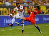 Jun 22, 2016; Chicago, IL, USA; Colombia forward Roger Martinez (9) and Chile defender Gonzalo Jara (18) fight for the ball during the first half in the semifinals of the 2016 Copa America Centenario soccer tournament at Soldier Field. Mandatory Credit: Dennis Wierzbicki-USA TODAY Sports