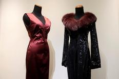 "A Dolce & Gabbana gown (L) and a Dolce & Gabbana ""Diva Train"" coat (R) that belonged to the late singer Whitney Houston, are seen on display at Heritage Auctions in Manhattan, New York, U.S., June 10, 2016, which are among the items of memorabilia in the ""Whitney Houston Collection"" which is being auctioned by Heritage Auctions June 24 in Beverly Hills, California. REUTERS/Mike Segar"