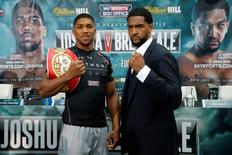 Britain Boxing - Anthony Joshua & Dominic Breazeale Head-to-Head Press Conference - Sky Sports Studios, Isleworth, Middlesex - 23/6/16 Anthony Joshua and Dominic Breazeale pose during the press conference Action Images via Reuters / Andrew Couldridge Livepic
