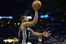 May 6, 2016; Oklahoma City, OK, USA; San Antonio Spurs forward Kawhi Leonard (2) shoots the ball against the Oklahoma City Thunder during the fourth quarter in game three of the second round of the NBA Playoffs at Chesapeake Energy Arena. Mandatory Credit: Mark D. Smith-USA TODAY Sports