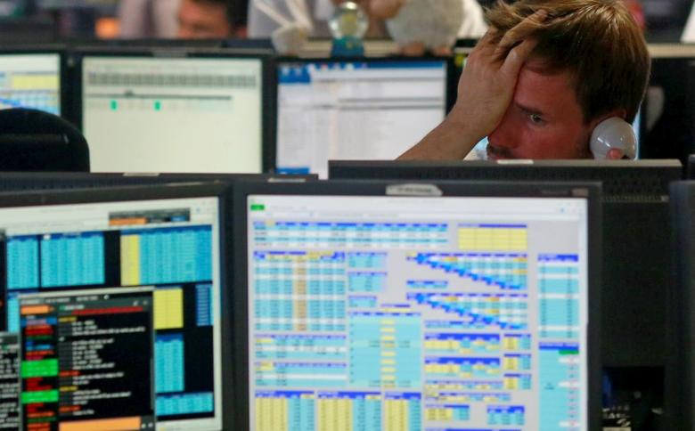 Traders from BGC, a global brokerage company in London's Canary Wharf financial centre react as European stock markets open early June 24, 2016 after Britain voted to leave the European Union in the EU BREXIT referendum. REUTERS/Russell Boyce