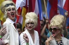 Participants dressed as actress Joanna Lumley take part in the annual Pride London Parade, which highlights issues of the gay, lesbian and transgender community, in London, Britain June 25, 2016. REUTERS/Neil Hall