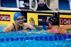Jun 27, 2016; Omaha, NE, USA; Katie Ledecky and Leah Smith after the women's freestyle 400m final in the U.S. Olympic swimming team trials at CenturyLink Center.  Erich Schlegel-USA TODAY Sports