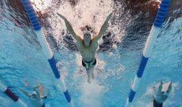 Jun 28, 2016; Omaha, NE, USA; Michael Phelps swims during the men's butterfly 200m preliminary heats in the U.S. Olympic swimming team trials at CenturyLink Center. Rob Schumacher-USA TODAY Sports
