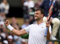Britain Tennis - Wimbledon - All England Lawn Tennis & Croquet Club, Wimbledon, England - 30/6/16 Bulgaria's Grigor Dimitrov celebrates winning his match  against France's Gilles Simon REUTERS/Tony O'Brien