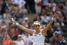 Britain Tennis - Wimbledon - All England Lawn Tennis & Croquet Club, Wimbledon, England - 30/6/16 Slovakia's Jana Cepelova celebrates winning her match against Spain's Garbine Muguruza REUTERS/Tony O'Brien