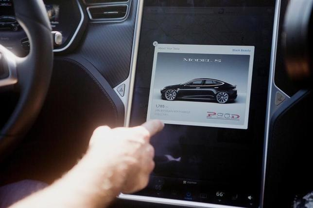 The Tesla Model S version 7.0 software update containing Autopilot features is demonstrated during a Tesla event in Palo Alto, California, U.S., October 14, 2015. REUTERS/Beck Diefenbach/File Photo