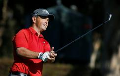 Greg Chalmers of Australia tees off on the 14th hole during the first round of the Northern Trust Open golf tournament at Riviera Country Club in Los Angeles February 14, 2013. REUTERS/Danny Moloshok