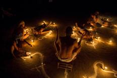 People take part in rituals at the Sorte Mountain on the outskirts of Chivacoa, in the state of Yaracuy, Venezuela October 10, 2015. REUTERS/Marco Bello