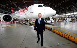 Lufthansa unit Swiss International Air Lines Chief Executive Thomas Kluehr stands in front of the airline's new Bombardier CS100 aircraft during a media presentation at Zurich airport, Switzerland July 6, 2016.     REUTERS/Arnd Wiegmann