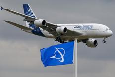 An Airbus A380, the world's largest jetliner, flies over a Boeing flag while landing after a flying display during the 51st Paris Air Show at Le Bourget airport near Paris, in this June 18, 2015 file photo. REUTERS/Pascal Rossignol  - RTX1H3TX