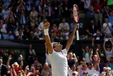 Britain Tennis - Wimbledon - All England Lawn Tennis & Croquet Club, Wimbledon, England - 6/7/16 Switzerland's Roger Federer celebrates winning his match against Croatia's Marin Cilic REUTERS/Paul Childs