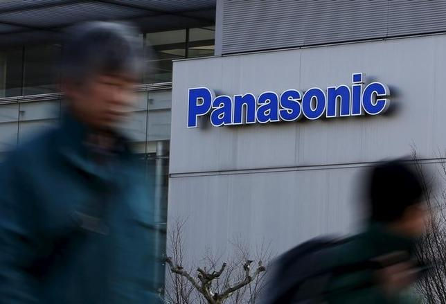 Pedestrians walk past a logo of Panasonic Corp outside Panasonic Center in Tokyo, Japan, February 3, 2016.  REUTERS/Yuya Shino