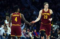 Jan 29, 2016; Auburn Hills, MI, USA; Cleveland Cavaliers center Timofey Mozgov (20) high fives guard Iman Shumpert (4) during the first quarter against the Detroit Pistons at The Palace of Auburn Hills. Mandatory Credit: Tim Fuller-USA TODAY Sport