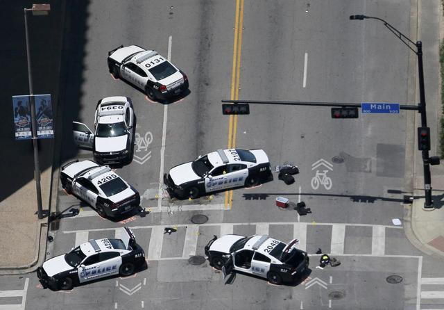 Police cars remain parked with the pavement marked by spray paint, in an aerial view of the crime scene of a shooting attack in downtown Dallas, Texas, U.S. July 8, 2016.  REUTERS/Brandon Wade