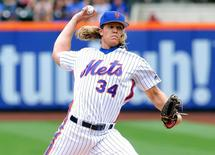 Jul 3, 2016; New York City, NY, USA; New York Mets starting pitcher Noah Syndergaard (34) pitches against the Chicago Cubs during the first inning at Citi Field. Mandatory Credit: Andy Marlin-USA TODAY Sports