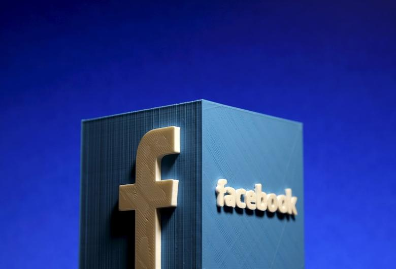 A 3D plastic representation of the Facebook logo is seen in this illustration in Zenica, Bosnia and Herzegovina, May 13, 2015. REUTERS/Dado Ruvic