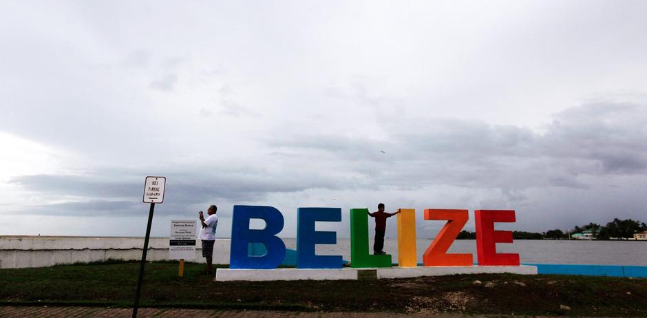 Special report caribbean countries entangled by us financial people gather on a tourist boardwalk in belize city belize june 22 2016 to match special report usa bankingcaribbean reutersjose cabezas sciox Images