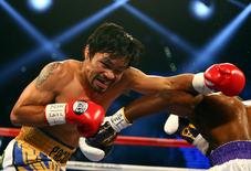 April 9, 2016; Las Vegas, NV, USA; Manny Pacquiao moves in with a punch against Timothy Bradley at MGM Grand Garden Arena. Mark J. Rebilas-USA TODAY Sports