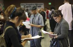 Job seekers fill out applications during the 11th annual Skid Row Career Fair the Los Angeles Mission in Los Angeles, California, May 31, 2012.   REUTERS/David McNew/File Photo