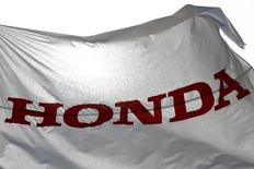 A flag with the company logo flies outside the Honda Motor Co. plant in Yorii, Saitama prefecture, Japan,  March 8, 2016. REUTERS/Thomas Peter