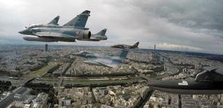 Four Mirage 2000C and one Alpha jet fly over Paris on their way to participate in the Bastille day parade, July 14 2016.  REUTERS/Philippe Wojazer