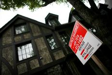 A home is put up for sale in downtown Montreal, July 14, 2009.   REUTERS/Shaun Best