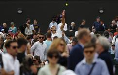 Britain Tennis - Wimbledon - All England Lawn Tennis & Croquet Club, Wimbledon, England - 30/6/16 General view of Croatia's Ivo Karlovic in action against Slovakia's Lukas Lacko REUTERS/Stefan Wermuth
