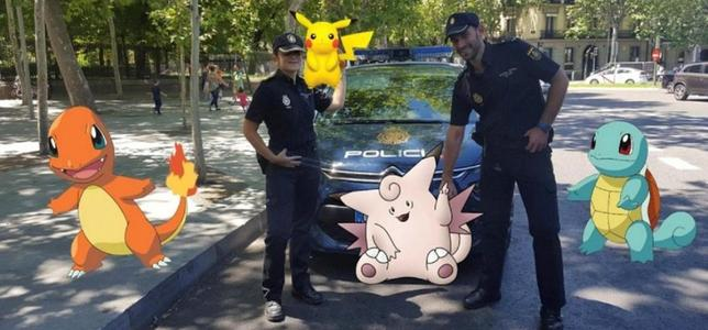 Spanish police pose with ''Pokemon Go''  figures in this handout picture provided by the Spanish Interior Ministry on July 18, 2016. Spanish Interior Ministry/Handout via REUTERS
