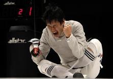 South Korea's Gu Bon Gil celebrates winning his men's individual sabre final against China's Zhong Man at the 16th Asian Games in Guangzhou, Guangdong province, November 19, 2010.  REUTERS/Mick Tsikas