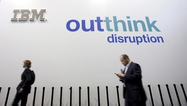 People walk past an IBM logo during the Mobile World Congress in Barcelona, Spain February 25, 2016. REUTERS/Albert Gea/File Photo