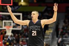 Apr 5, 2016; Atlanta, GA, USA; Phoenix Suns center Alex Len (21) reacts after the Suns scored a three point basket at the end of the quarter against the Atlanta Hawks during the first half at Philips Arena. Dale Zanine-USA TODAY Sports