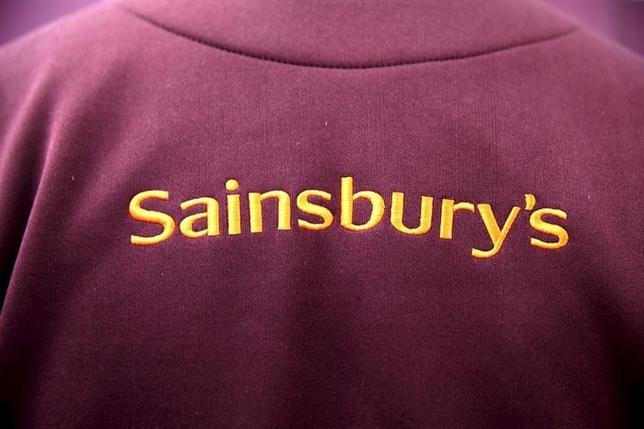 The Sainsbury's Logo is displayed on an employee uniform in a store in London, Britain December 3, 2015.  REUTERS/Neil Hall/File Photo
