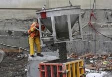 A worker pours concrete at a construction site in Ottawa, Canada, April 8, 2016. REUTERS/Chris Wattie