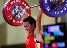 Sibel Ozkan of Turkey competes in the women's 48kg weightlifting clean and jerk competition at the World Weightlifting Championships in Antalya, southern Turkey, September 17, 2010. REUTERS/Osman Orsal